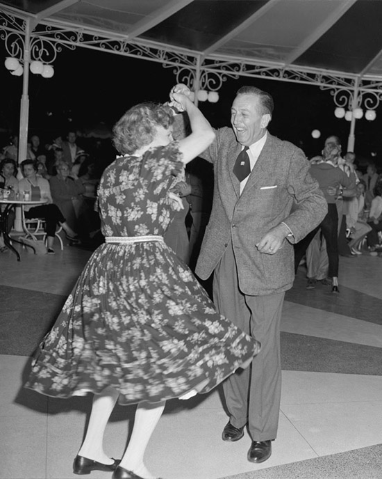 1958 Walt Disney enjoys a dance at Carnation Plaza